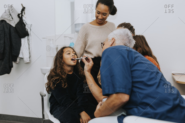 Parents with daughter in doctors office