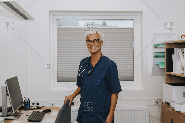 Smiling female doctor in office