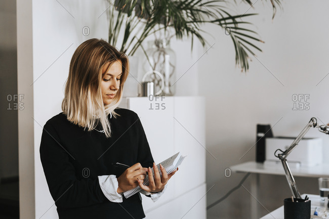 Woman taking notes in office