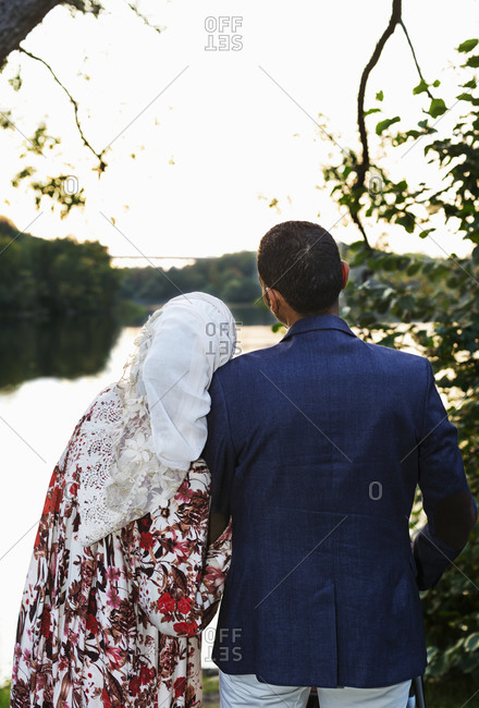 Rear view of couple at lake