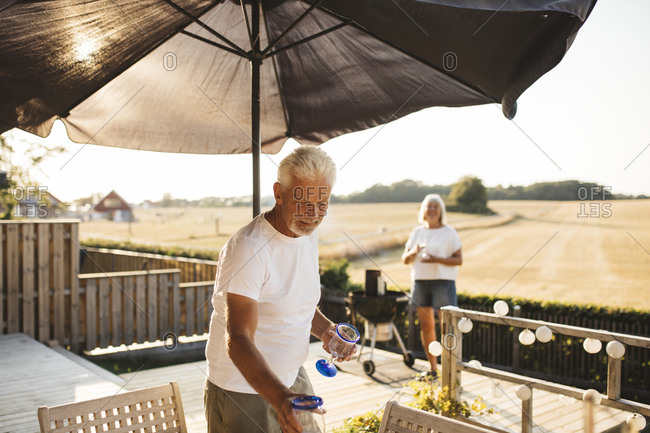 Man standing by table in garden