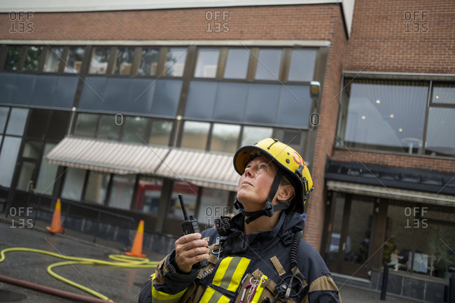Firefighter talking via walkie talkie