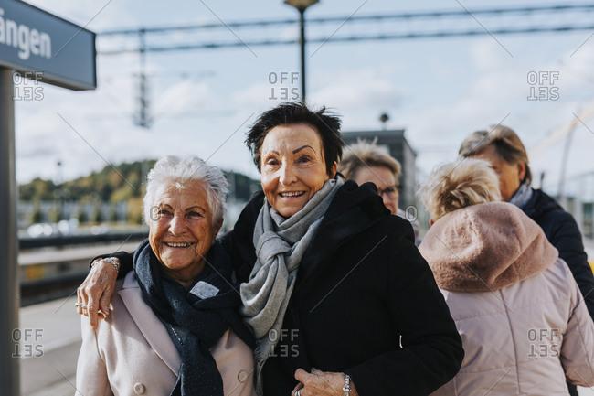 Women on train station platform