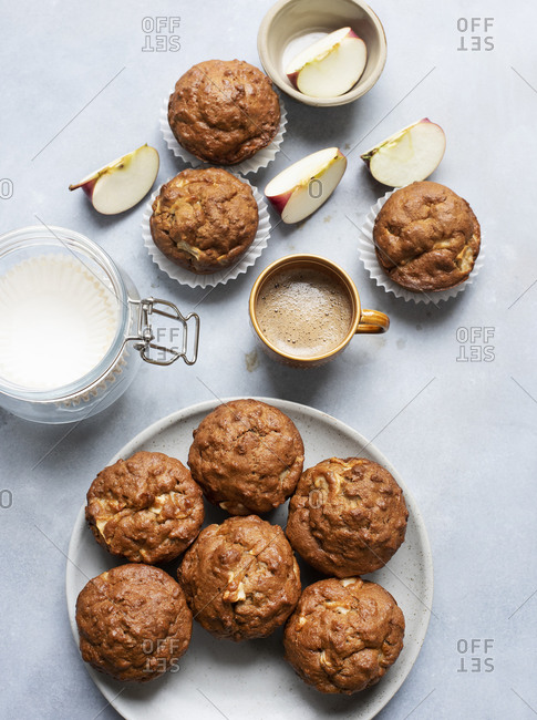 Apple muffins on a plate with black coffee