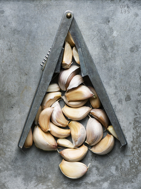 Cloves of garlic with a press in the shape of a Christmas tree