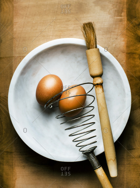 Eggs in a marble bowl with vintage beater