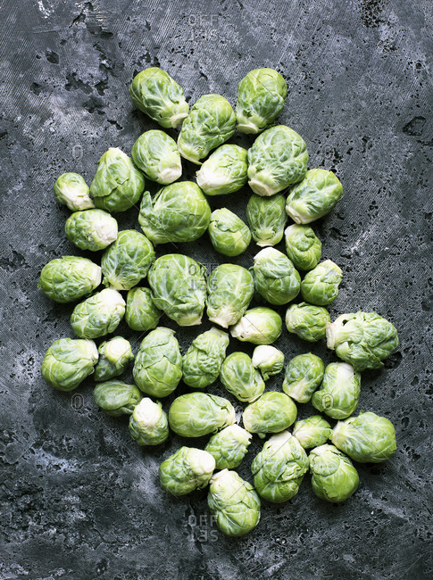 Down shot of brussels sprouts on stone background