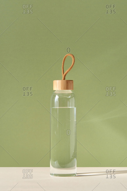 Reusable glass bottle of clean fresh water.