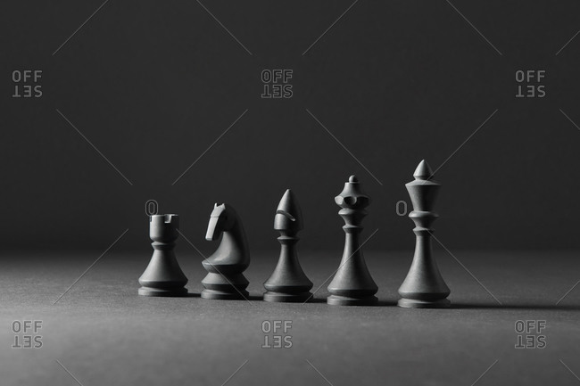 Black chess figures for playing.