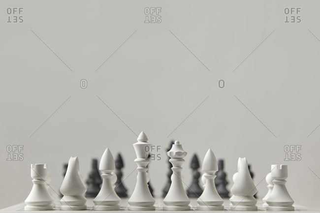 White chess figures before a game.