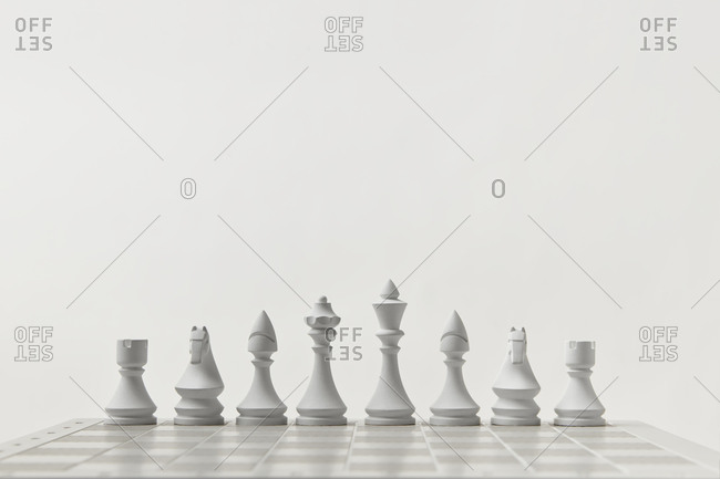 White chess figures on a board.