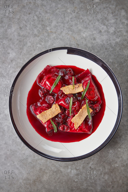 Tasteful dumplings with baked ricotta and cherry sauce.