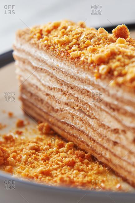 Closeup of honey cake with sour cream and honey crumbs.