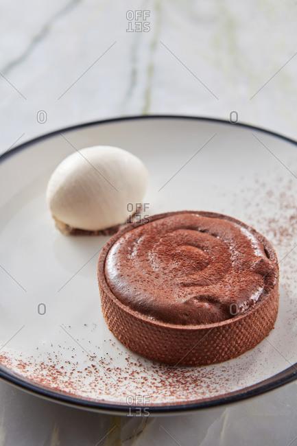 Chocolate souffle tart with cardamom ice cream.
