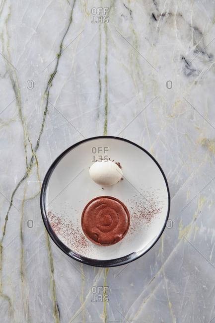 Top view chocolate souffle tart with cardamom ice cream.