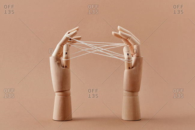 Mannequin's hands are playing a Cat's cradle game.