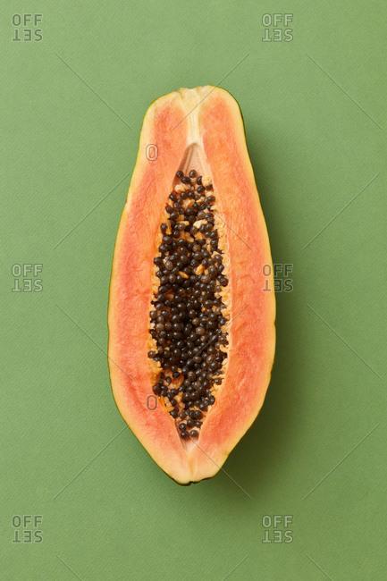 One half of ripe fresh organic papaya fruit.