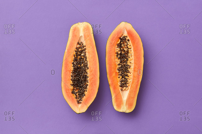 Two slices of fresh ripe papaya exotic fruit.