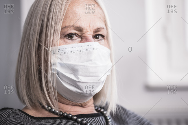 Portrait of an elderly woman wearing a facemask during a pandemic