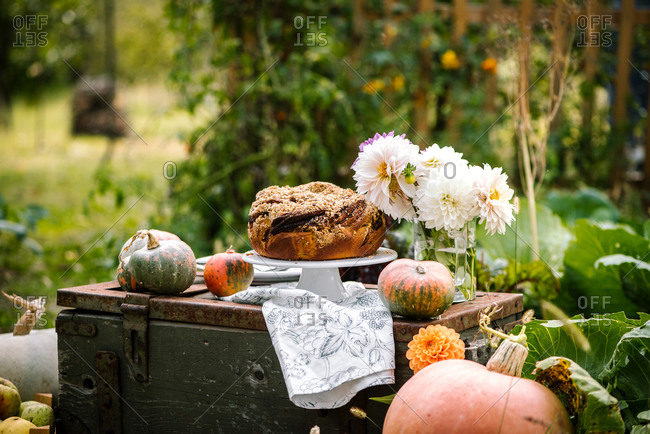 Sweet bread on an antique trunk with gourds