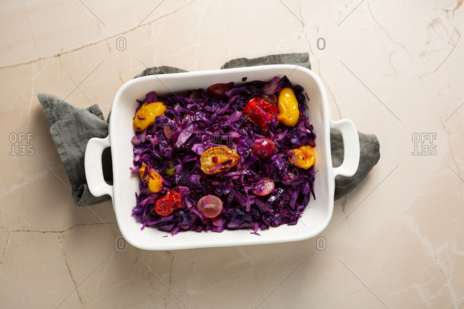 Overhead view of roasted red cabbage in a baking dish