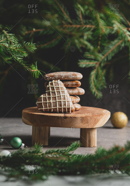 Heart shaped cookies on table with pine branches on background