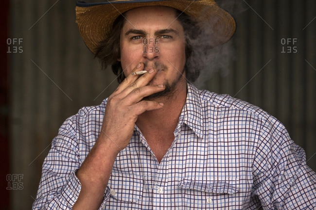 Farmer taking a smoke break in his barn