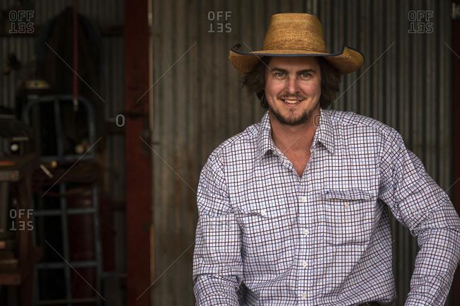 Portrait of a farmer taking a break in his barn