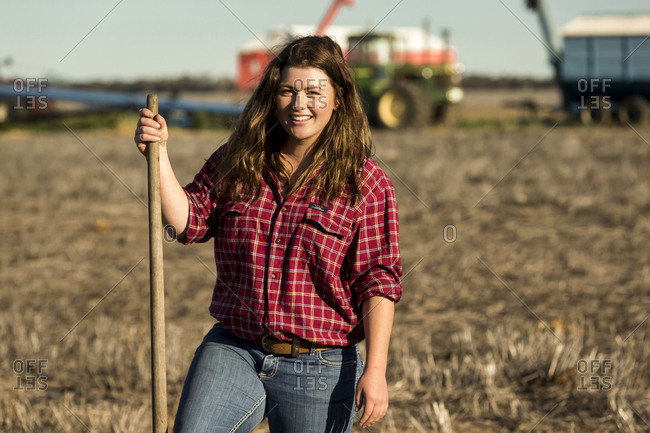 Young female farmer working in a field