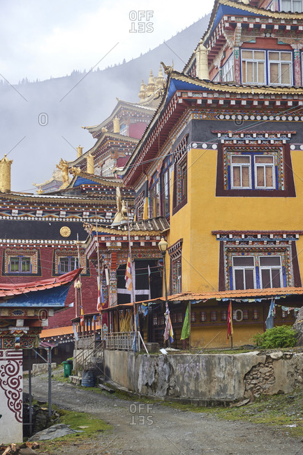 September 8, 2020: Exterior of aged small town Xinlong with residential authentic houses located in highland of China