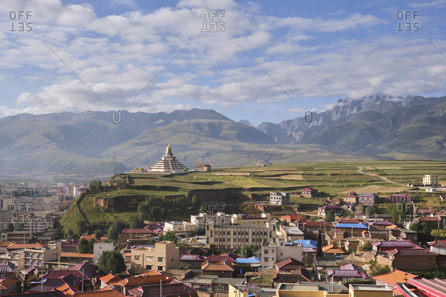 Ganzi, September 6, 2020: Picturesque city of Ganzi in misty high rocky mountains and spacious fresh plantations of Tibet