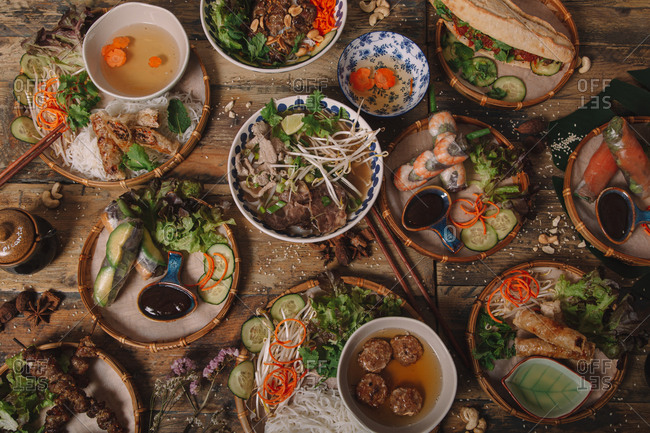 Top view of assorted dishes of Vietnamese cuisine arranged on wooden table in luxury restaurant