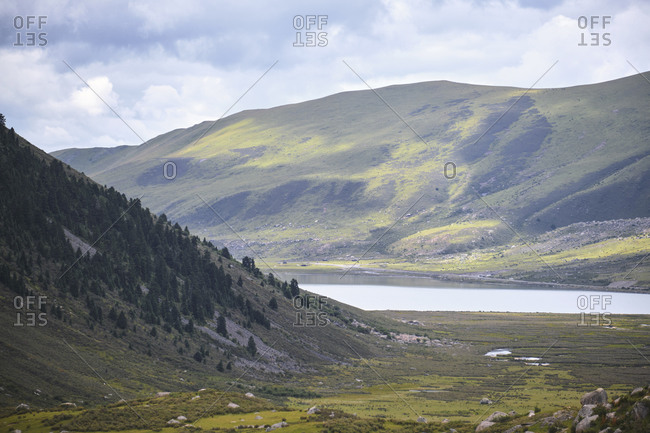 Majestic breathtaking scenery of picturesque nature of hills and peaks under blue sky in Tibetan area