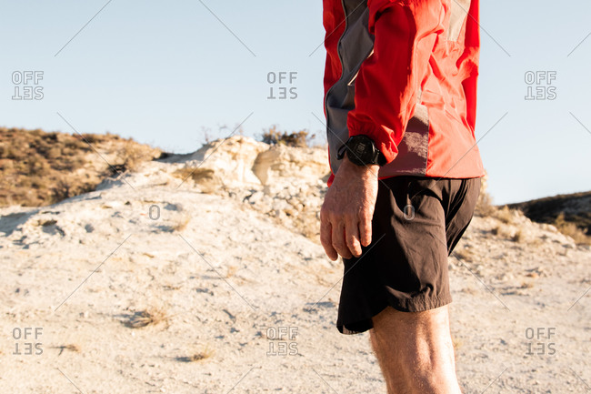 Sport watch detail of anonymous mature sportsman getting ready to run