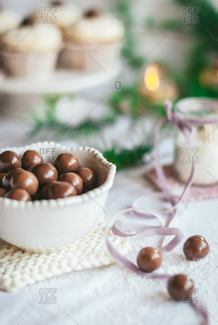 Heap of delicious chocolate balls in bowl placed on table in bright kitchen