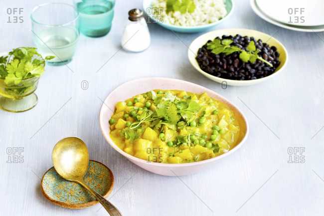 Potato pea curry with black beans and jade rice