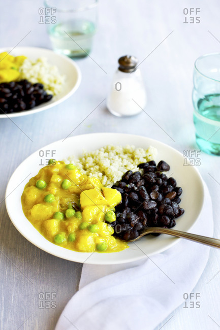 Close up of potato pea curry with black beans and jade rice