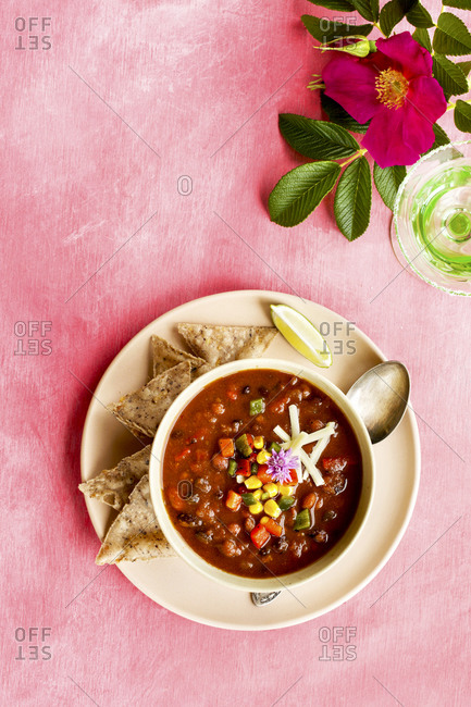 Spicy four bean chili on pink surface