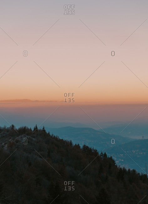 Aerial view with foggy sunrise over rolling hills