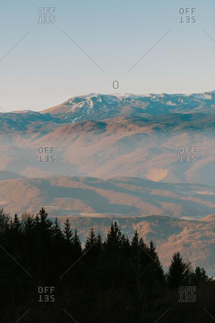 Haze covering mountain landscape