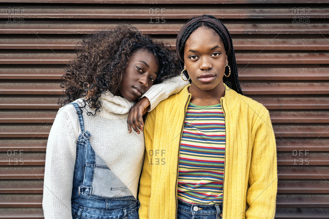 Black young friends looking at camera with expressive look in Madrid, Spain