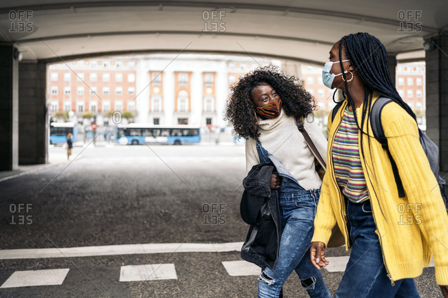 Black students talking and laughing in the street in Madrid, Spain They are wearing face mask due to covid19 in Madrid, Spain