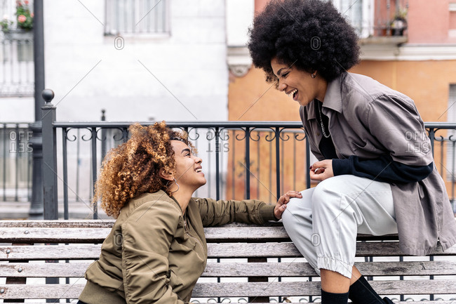 Cool afro girls talking and looking at each other in Madrid, Spain