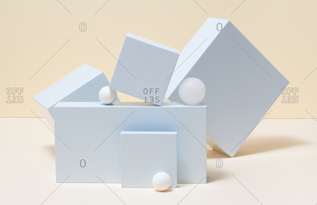 Still life with geometric shapes including cubes and balls