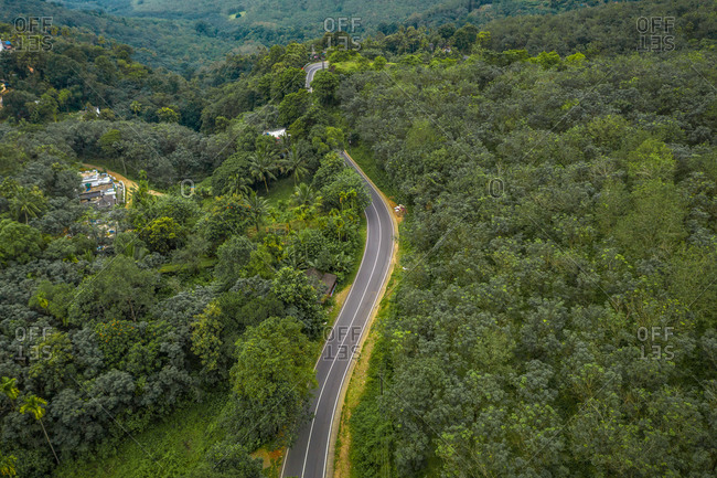 Aerial view of road through forest in Wandiperiyar, Kerala, India.