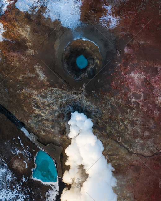 Aerial view of colorful geothermal steam pot, surrounded with red and yellow soil, rich in sulfur, another planet landscape Gunnuhver, Reykjanes Peninsula, Iceland