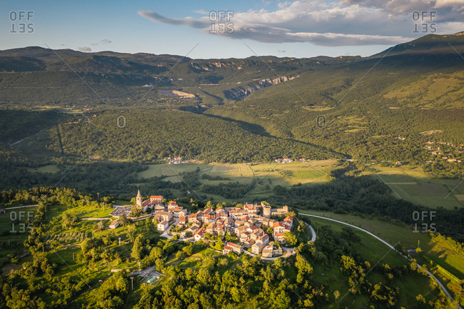 Aerial view of a village surrounded by mountains in Boljun, Croatia