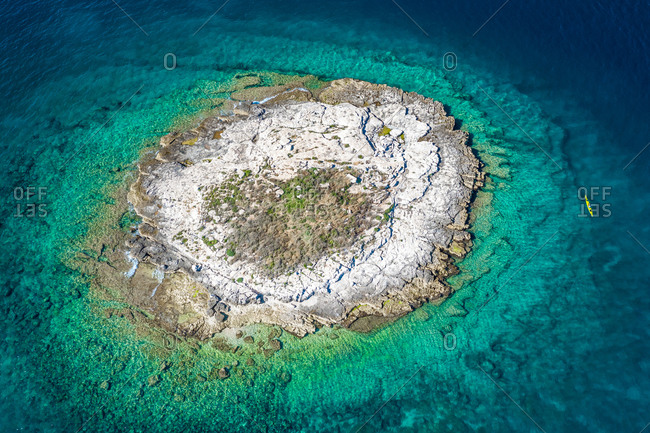 Aerial view of a kayak on the shore of Otocic Porer island in Bale, Croatia