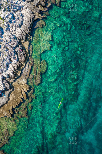 Aerial view of a kayak in the turquoise waters of Bale, Croatia