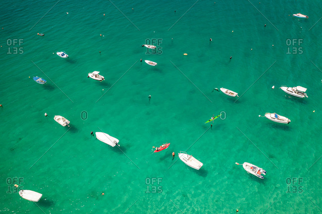 Aerial view of kayaks and boats in the turquoise waters of Bale, Croatia